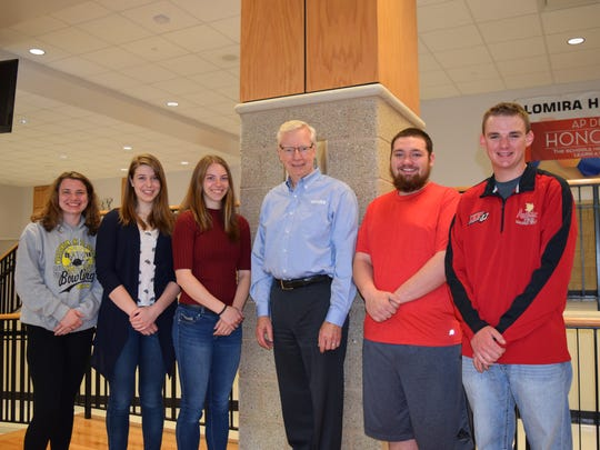 Kondex President Jim Wessing stands with scholarship