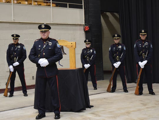 Officers stand at attention during the Knoxville-Knox
