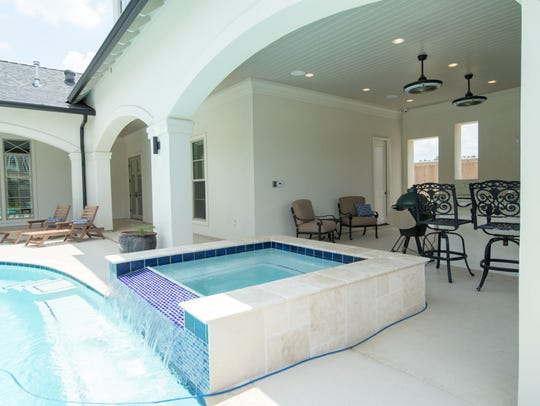 The outdoor space includes a beautiful pool and cooking