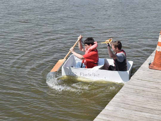 Principles of engineering students from Tioga High School built canoes made out of cardboard and duct tape. The canoes had to be seven feet long and three feet wide - enough to fit through a classroom door. Four teams consisting of four students each held a race at Lake Buhlow in Pineville on Tuesday to test their canoes' seaworthiness. Juniors Matthew Clark and Brashtion Cearley paddled the boat for their team. They came in second with a time of  25:53 seconds.