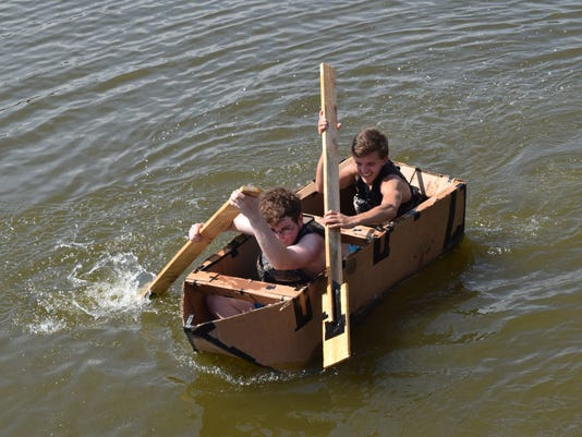 """Principles of engineering students from Tioga High School built canoes make out of cardboard and duct tape. Four teams consisting of four students each held a race at Lake Buhlow in Pineville on Tuesday to test their canoes' seaworthiness.  """"This is our priniciples of engineering class at Tioga High School that we offer,"""" said Chuck Perkins, engineering teacher and coach. """"And this the second phase of engineering."""" Perkins said thermodynamics, weight displacement and water displacement were among the things students learned in the course. """"And so with this challenge, they've taken all these things that they've learned over the two courses of engineering and applied them into actually building a cardboard boat to see how well it's going to float,"""" said Perkins. Four teams were made up of four students with two students from each team riding in the canoe. The canoes raced about 20 feet along the dock to see who had the best time. """"This is our first year offering this course. We're going to be offering it again next year and for years to come actually,"""" said Perkins. One cardboard canoe sank at the starting line while the other three were able to float 20 feet to the finish. The team consisting of junior Cabel Stockwell and sophomores Koby Saucier, Carey Hudson and Jospeh Newman won the race with their cardboard canoe. They had the fastest time of 13:38 seconds. Perkins took the winning team to the restaurant of their choice, Popeyes Louisiana Kitchen, for a meal. Perkins also said the winning team would also choose the meals that the """"losers"""" were going to eat. Afterwards, he treated all the students to dessert at Sweet Frog."""