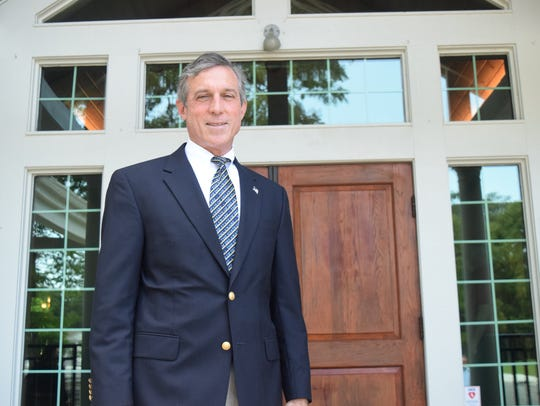Gov. John Carney stands outside Kings Creek Country Club on May 23.