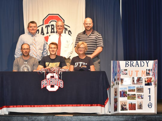 Oakland track and field standout Brady Fry recently signed with UT-Martin. Pictured in the front row (l-r) are father Bryan Fry, Brady Fry and mother Wendy Fry,. In the back row (l-r) are Oakland principal John Marshall, Oakland track and field coach Al Evans and athletic director Brad Cowan.