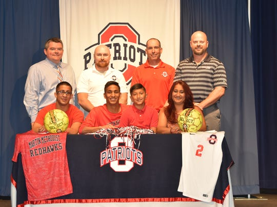 Oakland soccer standout Noor LaLani recently signed with Martin Methodist College. Pictured in the front row (l-r) are Navin Lalani, Noor Lalani, Naail Lalani and Mywish Jessan. Pictured in the back row are Oakland principal John Marshall, Oakland soccer coach Jeff Porter, Oakland soccer coach Vladmir Borobozim and athletic director Brad Cowan.