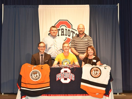 Oakland hockey standout Ryan Seibert recently signed ato play at the University of Tennessee. Pictured in the front row (l-r) are his father, Dave Seibert, Ryan Seibert and his mother, Dina Seibert. In the back row are Oakland principal John Marshall and athletic director Brad Cowan.