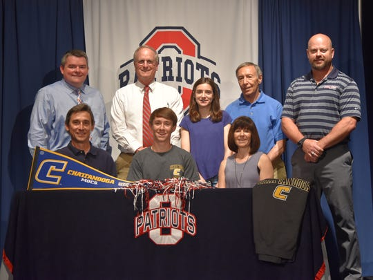 Oakland cross country standout Ryan Phillips recently signed with Chattanooga. Pictured in the front row (l-r) are father Claude Phillips, Ryan Phillips and mother Jennifer Phillips. In the back row (l-r) are Oakland principal John Marshall, Oakland cross country coach Al Evans, sister Sarah Phillips, David Brand and athletic director Brad Cowan.