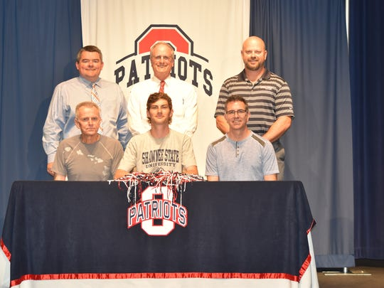 Oakland cross country and track and field standout Dalton Kerschieter recently signed with Shawnee State University  in Ohio. Pictured in the front row are Darren Kerschieter, Dalton Kerschieter and and Dennis Kerschieter. In the back row (l-r) are Oakland principal John Marshall, Oakland cross country and track coach Al Evans and athletic director Brad Cowan.
