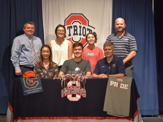 Oakland swimming standout Joey Clemmer recently signed with Carson-Newman. Pictured in the front row (l-r) are mother Noriko Clemmer, Joey Clemmer and father Mike Clemmer, Pictured in the back row (l-r) are Oakland principal John Marshall, Nicole Clemmer, Amy Clemmer and athletic director Brad Clemmer.