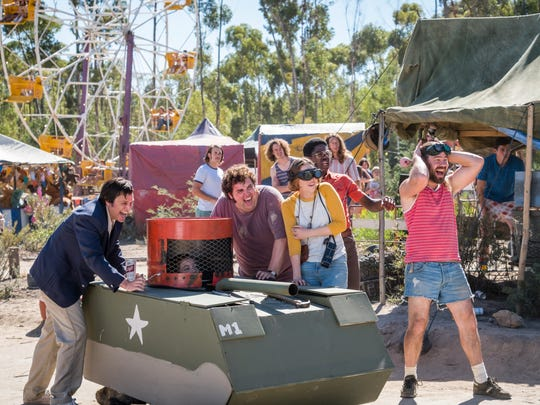 """Johnny Knoxville (left) and friends set in motion a definitely dangerous amusement-park attraction in the comedy """"Action Point."""""""