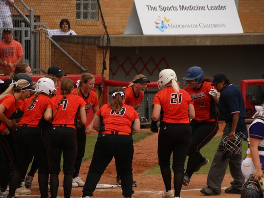 North Union celebrates a solo home run by Avery Clark that tied the game at 1-1 in the bottom of the seventh inning. Warren Champion rallied in the eighth for a 2-1 state semifinal softball victory Friday afternoon at Akron's Firestone Field.