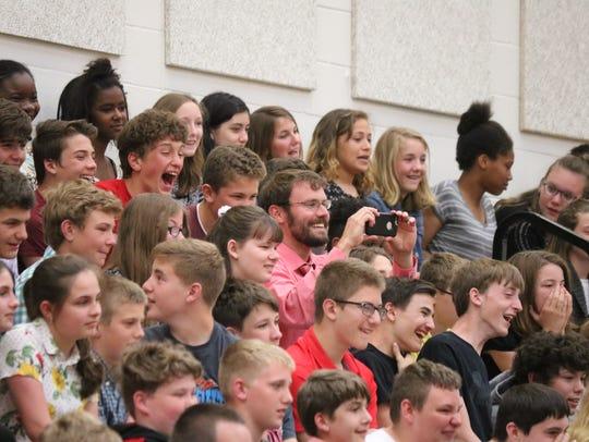 Port Clinton Middle School students applaud their peers,