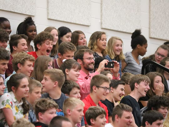 Port Clinton Middle School students applaud their peers,