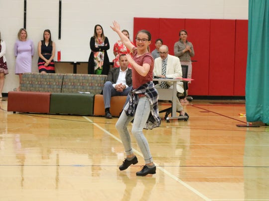 Olivia Felbinger performs a tap dance routine to a
