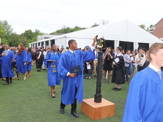 Graduating seniors ring the ceremonial bell at Dwight-Englewood