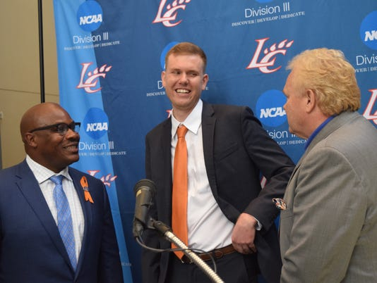 Reni Mason (lett) athletic director at Louisiana College, and Rick Brewer (right), LC president, announced Matt Lebato as the news women's head basketball coach Thursday. The 27-year-old is from Sulphur and a graduate of Northwestern State University.
