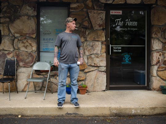 Chris Buckley stands outside the Haven, an informal