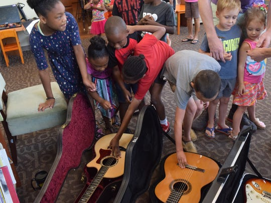 Benjamin Richey, a musician in the Alexandria, Louisiana, area, led a program about guitars to youngsters at the Westside Regional Library on Friday, June 8, 2018. He spoke to them about the the steel guitar, the classical guitar and the electrical guitar.