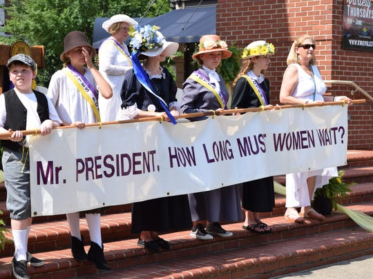 Marchers wearing period costumes demonstrate in downtown Knoxville on behalf of women's voting rights on Saturday, June 9, 2018. They were commemorating Tennessee's role in the passage of the 19th Amendment.