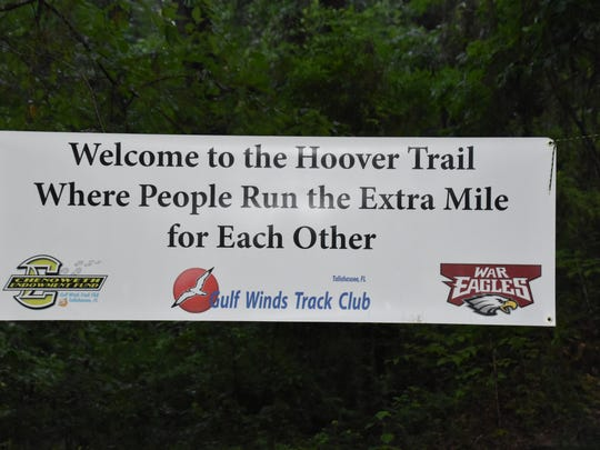 Banner on the Potluck 4-mile race trail honoring the
