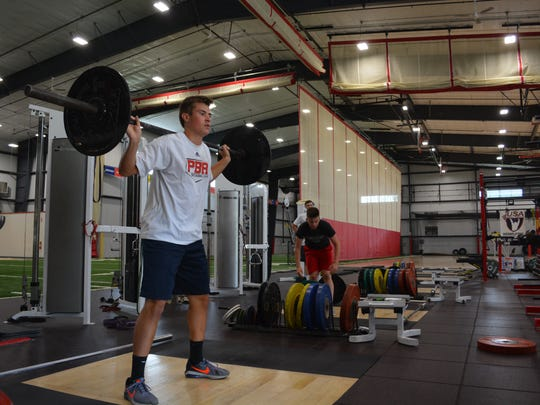 Jeff Hynes, a Brookfield Academy graduate bound for Austin (Texas) College, where he'll play baseball, works out inside NX Level Training facility on June 6.