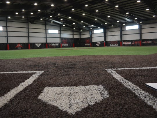 Batters can step up to the plate indoors at Stiks Academy & Sports Training facility. In addition to offering ballplayers the opportunity for some live hitting, the field helps infielders with repetitions to fine tune their skills, trainers say.