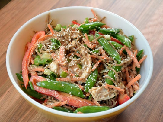 Soba noodles combine with veggies, chicken and an Asian