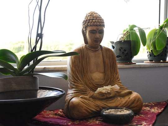 A shrine is on display inside the Naples studio of Open Mind Zen on June 20, 2018.