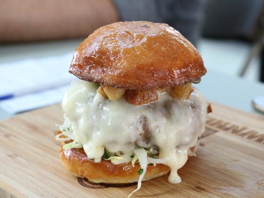 Townhouse Detroit burger was made from dry aged beef and drenched in aged white cheddar.