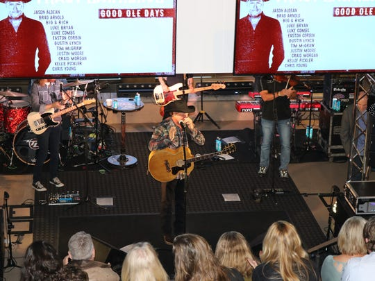 Country artist Tracy Lawrence performs recently at the stage inside the WME offices in Nashville.
