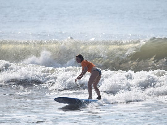 Kathy Horst, 36, catches a waves during the Ladies