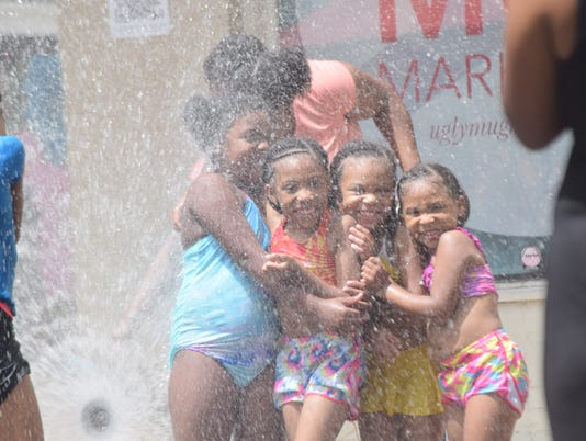 "TestFete was held Saturday, June 30, 2018 in downtown Alexandria. ""A Slide The City"" waterslide, which is a 1,000 foot waterside was placed on Murray street in front of City Hall. 