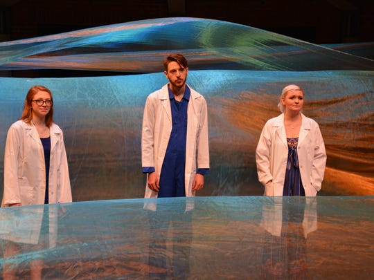 "From left: Chandler Bates, Graham Rogers and Ella Eggold play scientists in ""H2O: A Play About Water."" Throughout the play, the three offer a running commentary on just how essential water is to all of life on earth. The show was created by a group of CCM students who will open the production at Scotland's Edinburgh Fringe on August 4."