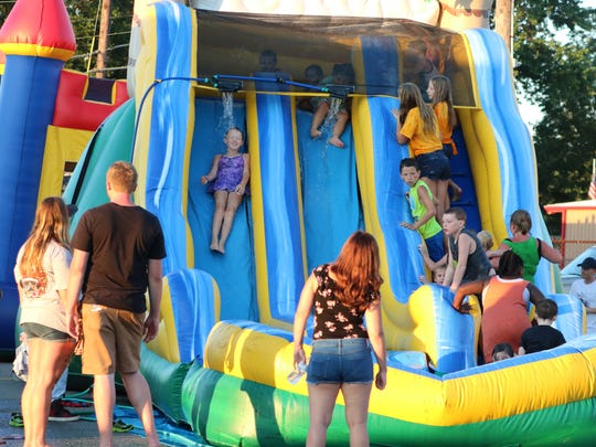 Children slide down the inflatables set up at Uniontown.