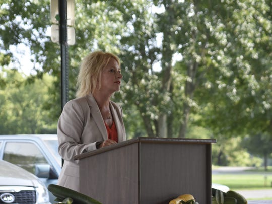Ashland City Attorney Jennifer Noe speaks at a dedication ceremony held in remembrance of former Councilman Chris LaCrosse under the pavilion at Riverbluff Park on Tuesday, July 10.
