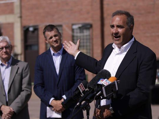 David Billion (right) speaks along with Mayor Paul