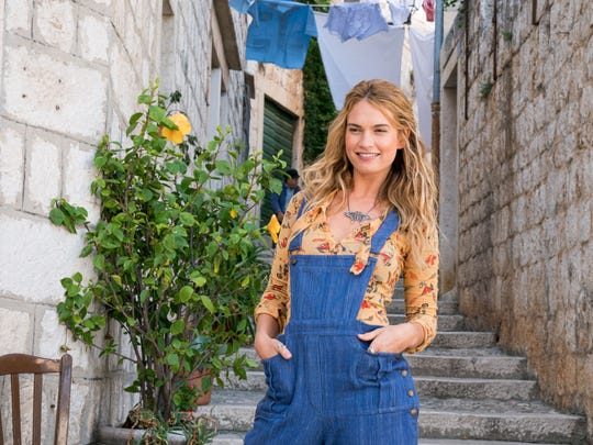 """Donna (Lily James) moves to Greece in """"Mamma Mia! Here"""