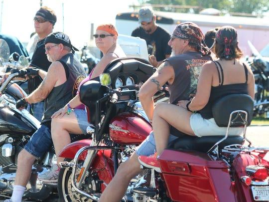 Bikers prepare for the poker run on Saturday.