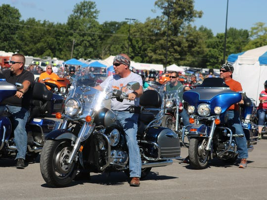 A group of motorcyclists line up for the Poker Run.