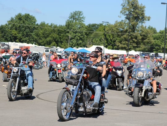 Bikers ride through the rally.
