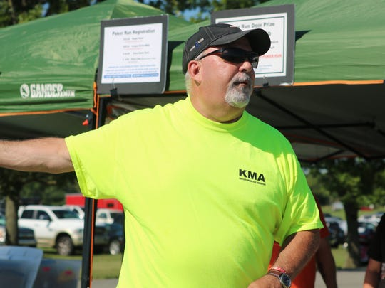 KMA officer, David Holt, points bikers in the right direction at the rally.