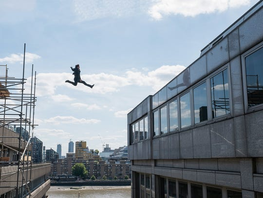 "Tom Cruise jumps between buildings in London for ""Mission:"