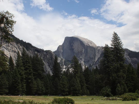 Yosemite's iconic Half Dome seen Thursday, July 12, before smoke filled the park, which will be partially closed Wednesday.