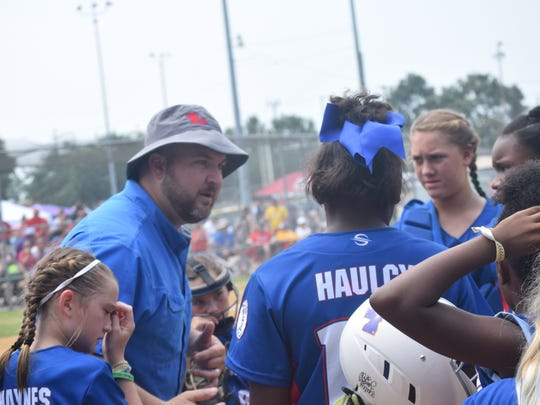 Louisiana Angels coach Tony Bonsall (left) talks to his team during its opening round game with Ward 10 Saturday. Dixie Softball World Series held Saturday, July, 28, 2018 at the Alexandria Youth Complex. Alexandria is hosting all nine divisions of Dixie Softball's World Series from July 28-Aug. 1.About 95 teams from 10 states are playing at Johnny Downs Sportsplex and the Alexandria Youth Complex. Johnny Downs will host the Angels X-Play, Belles, Debs and Ponytails X-Play tournaments. The Angels Traditional, Darlings, Ponytail Traditional, SweeTees Traditional and SweeTees X-Play brackets will play out at the Alexandria Youth Complex.