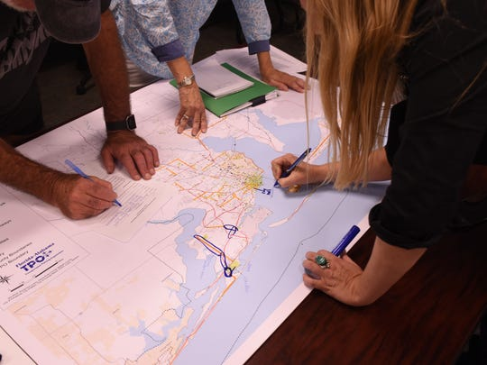 A group of residents point out locations where they would like to see sidewalks, bike lanes and other amenities during a July 26 work session of the Florida-Alabama Transportation Planning Organization's Pedestrian-Bicycle Master Plan.