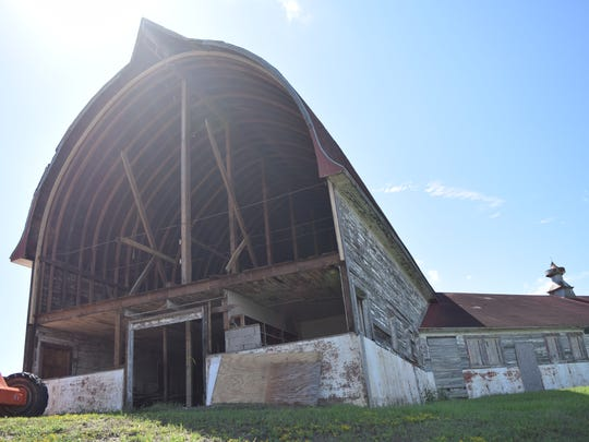 The rafters on the second floor of the Central Dairy Barn are seen last year before the building's decaying north wall was rebuilt.
