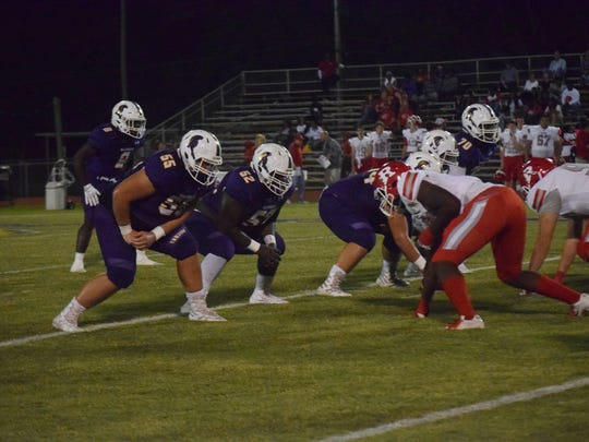 ASH junior Dylan Dauzart (55) has been part of a Trojan offensive that has blocked for the last two All-Cenla MVPs.