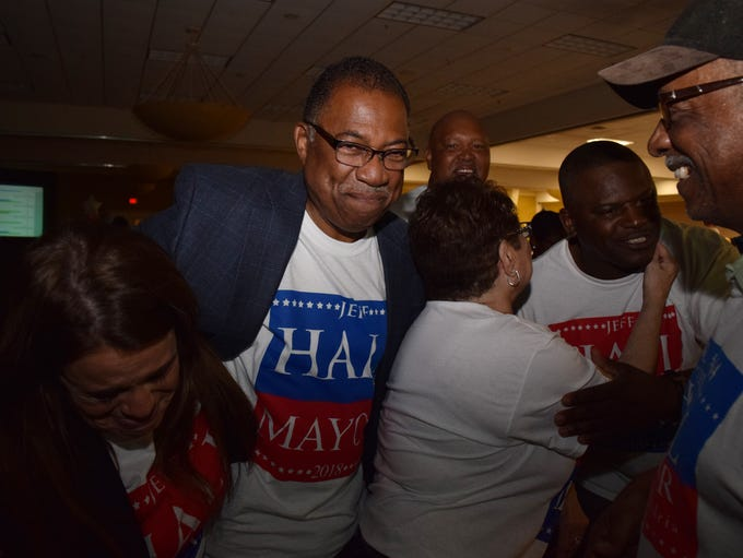 Jeff Hall celebrates his mayoral win with supporters