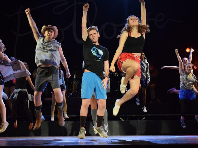 Austin Tinsley (center) stars as Ren McCormack, Mia