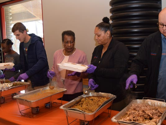 """For the past 10 years, Frances Perry, 31, along with her family and a host of volunteers, have been hosting a free Community Thanksgiving at the Broadway Resource Center on Broadway Avenue in Alexandria. Perry took over serving the Community Thanksgiving about 11 years ago after the Rev. Euell Williams passed away. Perry was in the sixth grade when she first started helping out with the community feast. Her grandmother took her to serve meals on 3rd Street under Williams' direction. She was a student at the University of Louisiana at Monroe when Williams died. Perry, at the time only 21, asked her mother Cynthia Perry about taking over serving the Community Thanksgiving meal. With the help of family, friends and volunteers, the tradition Williams started was able to continue. Letters are sent out seeking donations to pay for the cost of the food served such as turkey, dressing, green beans, gravy, cranberry sauce, cake, roll and a drink. Frances' father Ralph Perry and other volunteers smoke turkeys for the meal. Frances, Cynthia and other volunteers prepare and heat food in the kitchen of the center. This year the cornbread dressing was prepared by the cafeteria workers at Peabody Magnet High School. Elmay Garrett has eaten at the Community Thanksgiving at the Broadway Resource Center for over 8 years. """"I'm overjoyed to come each year,"""" said Garrett. I love to come around such lovely people."""" The meal was served from 11 a.m. to 3 p.m. After this meal is concluded, Frances starts planning and preparing next year's meal."""