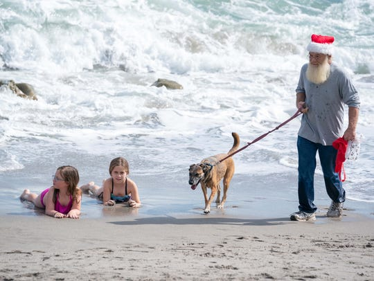 Even Santa and his dog got into the act Nov. 25 at